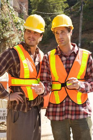 Two Construction Workers at the job working together Stock Photo - 5280454