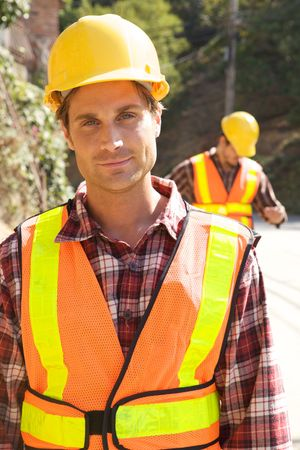 A Construction Worker on the job with a hard hat Stock Photo - 5280445