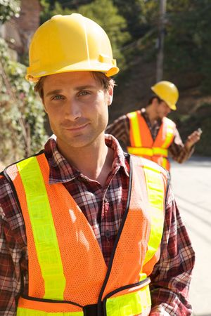 A Construction Worker on the job with a hard hat Stock Photo - 5280411