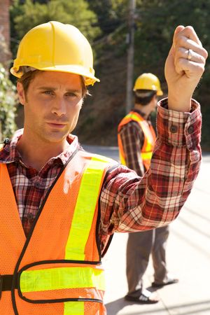 A Construction Worker on the job with a hard hat Stock Photo - 5280449