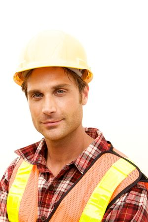 A Construction Worker on the job with a hard hat