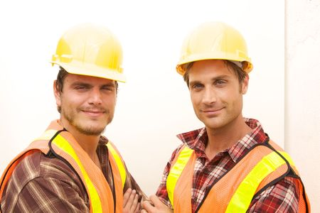 Two Construction Workers at the job working together Stock Photo - 5280478