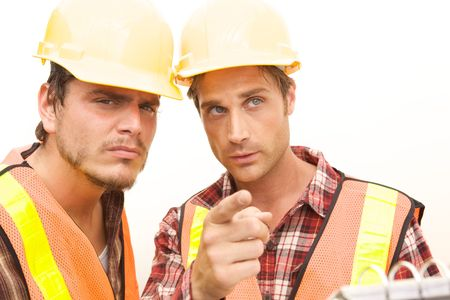 Two Construction Workers at the job working together photo