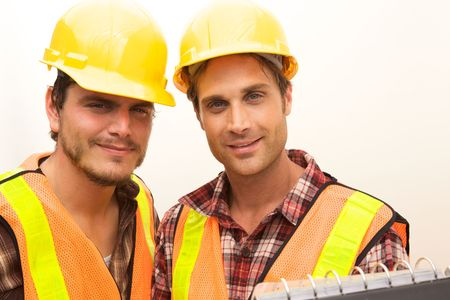 Two Construction Workers at the job working together