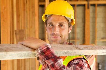 A closeup of a construction worker with a hard hat Stock Photo - 5280447