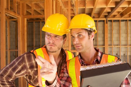 Two Construction Workers at the job working together Stock Photo - 5280213