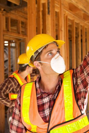 A Construction Worker on the job with a hard hat Stock Photo - 5280439