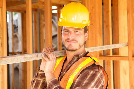 A closeup of a construction worker with a hard hat