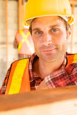 A closeup of a construction worker with a hard hat Stock Photo - 5280448