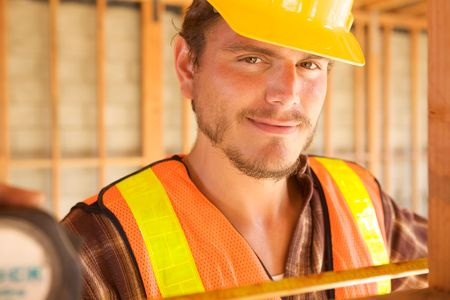 A closeup of a construction worker with a hard hat photo
