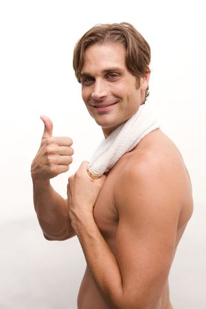 A Closeup of a happy man with no shirt and a towel photo
