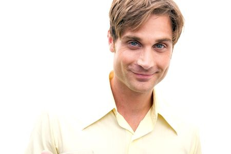smirking: A healthy looking man smirking for the camera Stock Photo