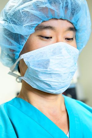 A female nurse looking at the camera in scrubs photo