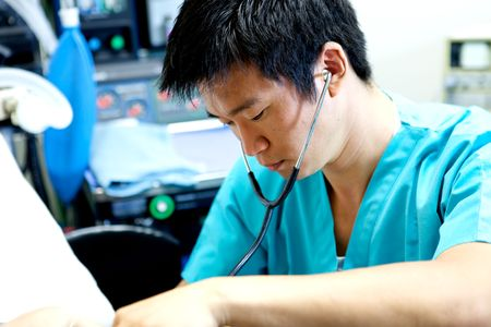 An Asian Doctor working in a hospitalA doctor nurse team at a hospital photo