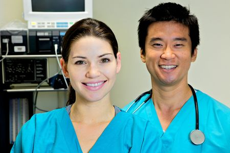 A female nurse looking at the camera in scrubsA doctor nurse team at a hospital Stock Photo