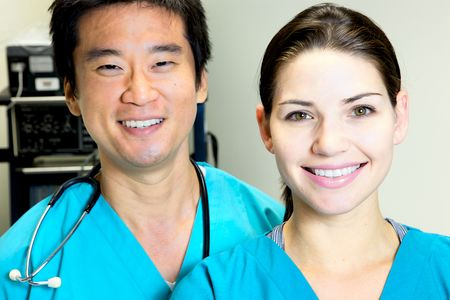 A female nurse looking at the camera in scrubsA doctor nurse team at a hospital photo