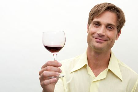 A young man toasting with a glass toward camera photo