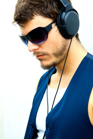 liesure: An attractive man with headphones and a blue vest