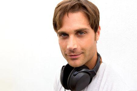 liesure: A good looking blond boy with headphones around his neck Stock Photo
