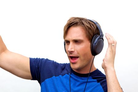 jamming: An attractive man with headphones and a blue vestA handsome man jamming out to music