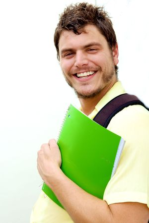 A young man with a knapsack smiling