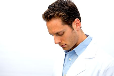 A young doctor looking down in thought photo