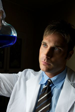 A young scientist conducting an experiment in a lab
