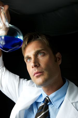A young scientist conducting an experiment in a lab Stock Photo - 5437734