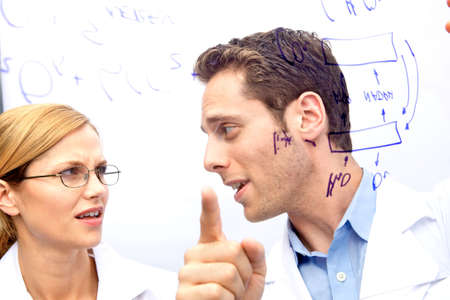 Two Scientists working out a problem together Stock Photo - 5437789