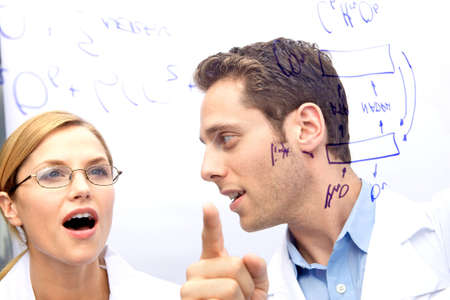 Two Scientists working out a problem together Stock Photo - 5437783