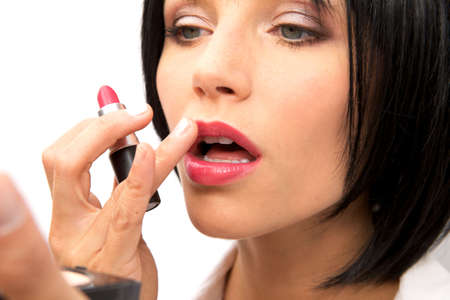A beatiful woman applying red lipstick Stock Photo - 5466026