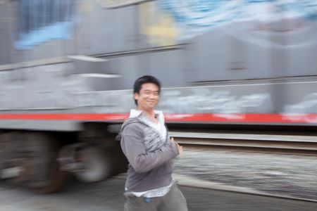 A funny motion blur of an asian man running Stock Photo - 5501053