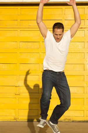 flying man: A man jumping off with shadow behind him Stock Photo