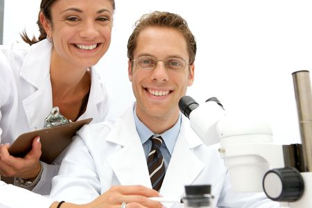 A female and male scientist working in a lab Stock Photo - 5559227