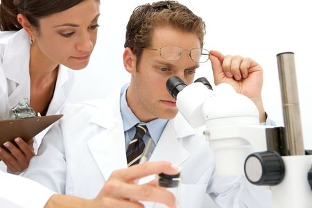 A female and male scientist working in a lab Stock Photo