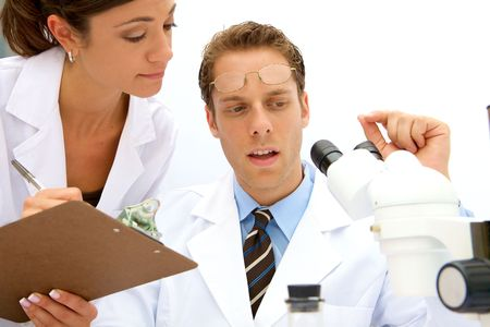 A female and male scientist working in a lab Stock Photo - 5559234