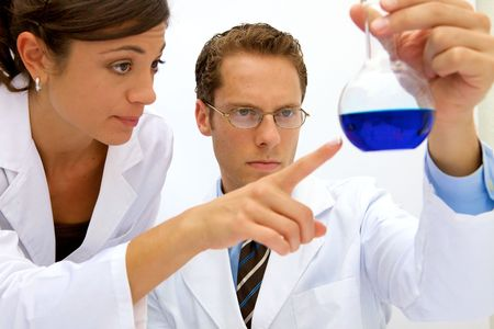 A female and male scientist working in a lab Stock Photo - 5559232