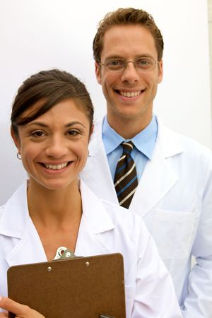 A female and male scientist working in a lab Stock Photo - 5559233