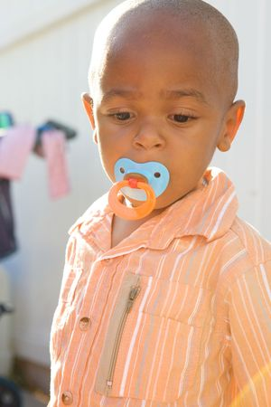 Cute African American Boy with a funny look photo