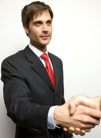 Attractive Young Businessman shaking hands off camera photo