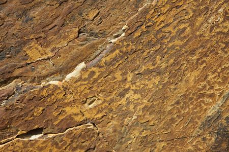 Brown Granite Background with grooves and cracks photo