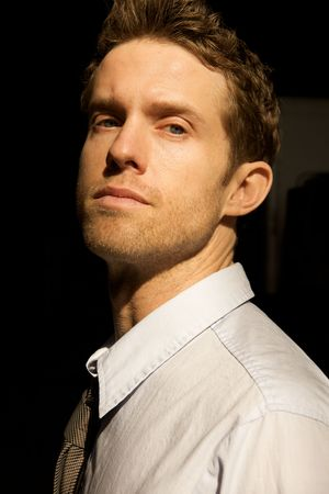 A Young Attractive Man with a serious look photo