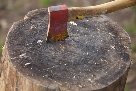 An  axe stuck into wood with blurred background Stock Photo - 6389439