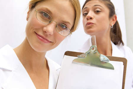 Two Funny Doctors Holding up a blank sign Stock Photo - 6474927
