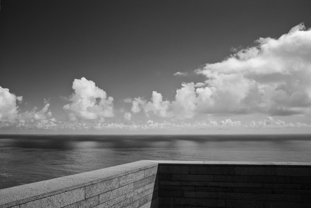 A shot taken from a balcony with a view over the sea, on a clear summer day  photo