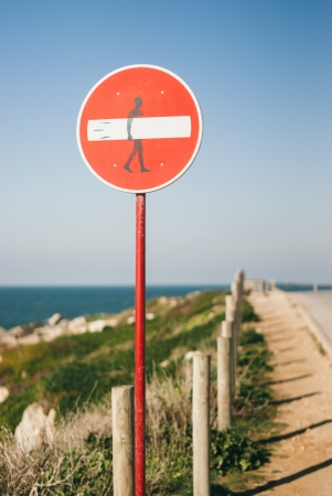 A street sign,  victim  of street art, in a very known surf zone in Portugal  Baleal, Peniche   Banco de Imagens