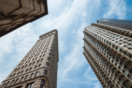 A shot taken from the street, pointing high to sky, showing the top of the tall skyscrapers of New York City. A sensation of vertigo. Stock Photo