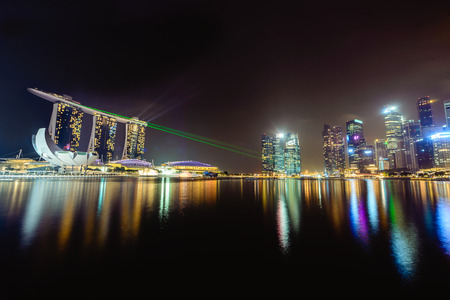 laser lights: A long exposure wide angle panorama at night of the Marina Bay in Singapore showing a beautiful show of laser and neon lights show.