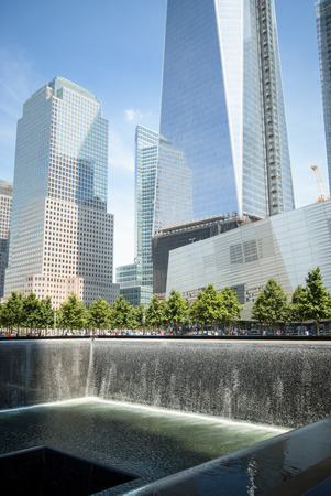 One of the waterfalls at the 911 memorial plaza set within the footprints of the original Twin Towers.