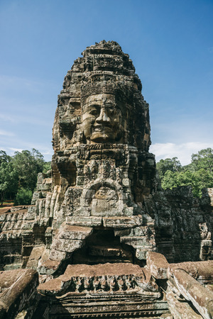 archaeological sites: A giant stone statue from the ancient temples of Angkor which is one of the most important archaeological sites in the world.